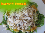 veganer Rhabarbersalat auf Blattspinat